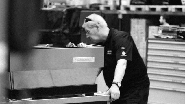 CMT working on servicing coffee machine