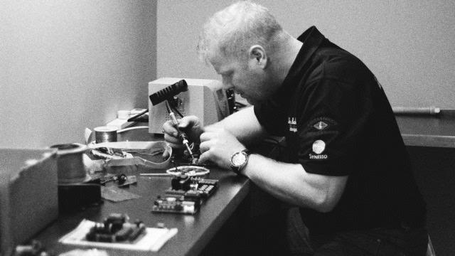 John Repairing Coffee Machine